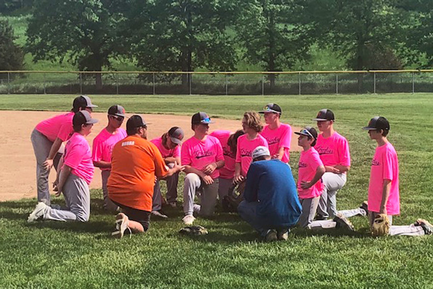 Coaches Bubba Ratfield and Seth Raymond talk to the age 14 and younger Blair Grizzlies baseball team after a weekend sweep.