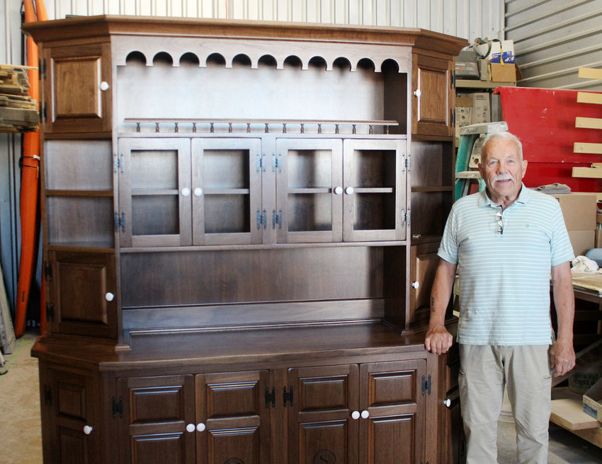 Blair resident Dan Hovanec with a hutch he custom built for a New York man 55 years after he built one for the man's mother. The hutch will be shipped to Long Island, N.Y., this week.