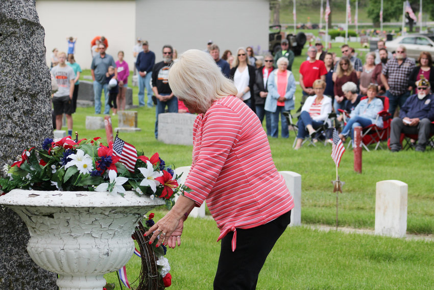 Kristi Rounds places a wreath during the Memorial Day ceremony Monday in Blair.