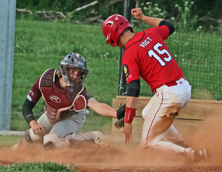 Arlington Senior Legion catcher Nick Smith, left, can't quite get to the Pender baserunner in time Wednesday at the Washington County Fairgrounds.