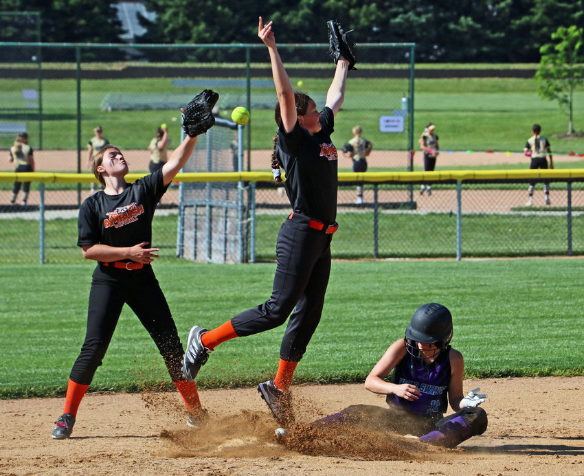 Blair Wilds Swings baserunner Maddie Smutny, right, slides safe into second base against the North Bend Ambush on Saturday during the BYSA Classic at the Youth Sports Complex.
