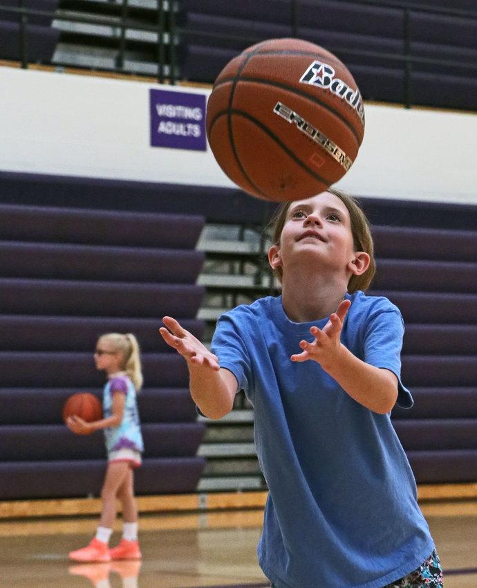 Harper Spader, 7, grabs a rebound Monday during the Blair Girls Basketball Clinic at BHS.