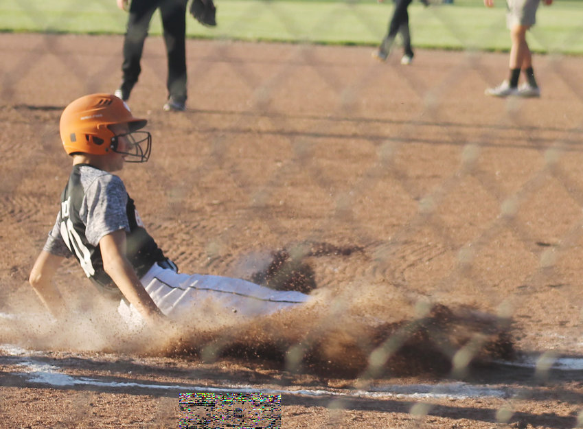 Preston Rost slides into home plate during the BRLD game.