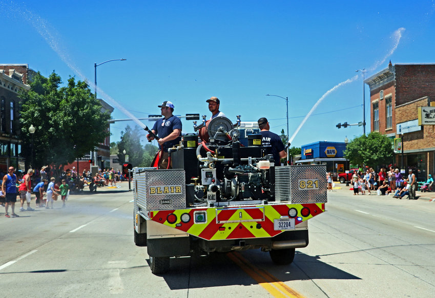 The Blair Volunteer Fire Department keeps the parade crowd cool Saturday in downtown Blair.