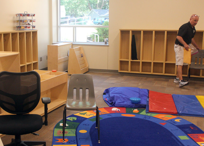 Jerry Green, Fort Calhoun Community Schools Superintendent, arranges a preschool classroom Wednesday morning. The new preschool area has two classrooms for morning and afternoon students.