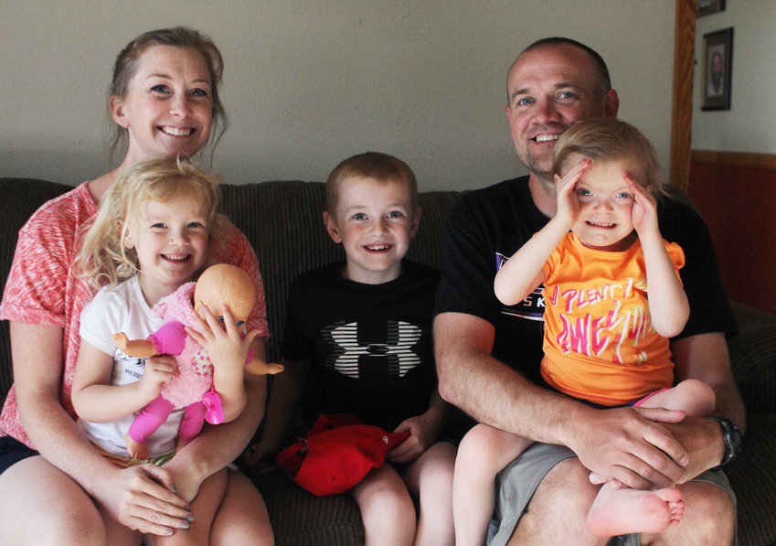 Bridget and Matt Aschoff with their children, Millie, left, Henry and Claire. Claire, 6, was born with special needs.