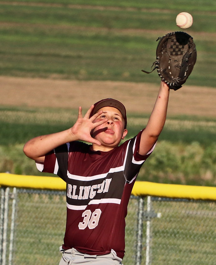 William Von Behren of Arlington Maroon Didget League team reaches for a high throw to first base Monday at the Two Rivers Complex. The Maroon age 10 and younger team played the Arlington White squad in Tri-County Baseball League competition.
