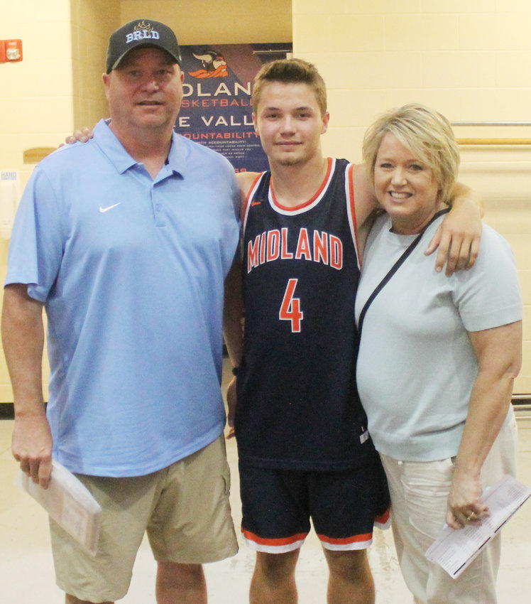Lucas Vogt with parents Brad and Karin.