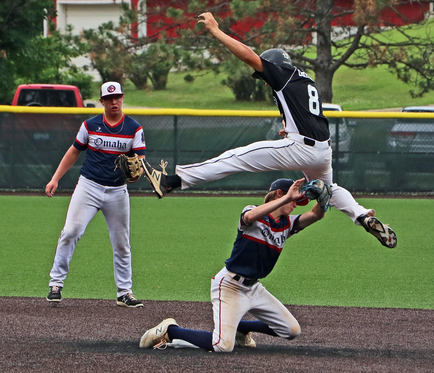 Blair Senior Legion baserunner Nolan Osterhaus hurdles to try and avoid an Omaha Spikes tag Saturday during a South Omaha tournament in Brown Park.