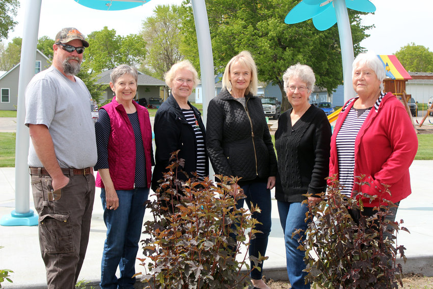 The Fort Calhoun Enhancement Committee is part of many different events and projects around the community, including taking care of watering flowers and making decisions based on beautifying the city. Pictured, second from left, members Lori Lammers, Rosemary Therkildsen, Beth Dieteman, Jackie Henderson and Judy Boyd. Also pictured is Fort Calhoun Maintenance Supervisor Corban Helmandollar.