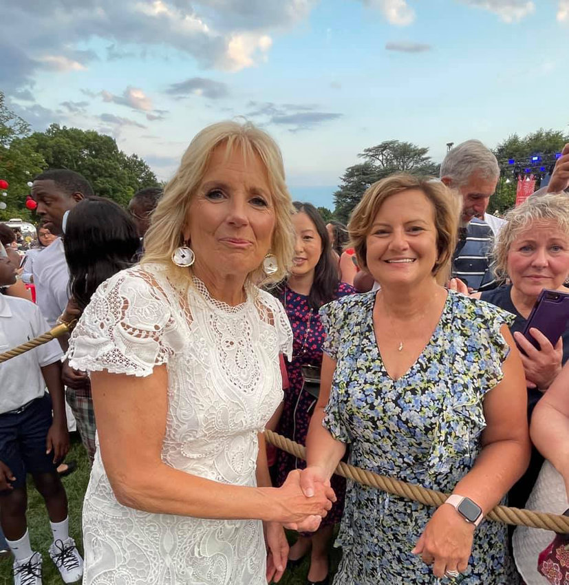 Manny Banner, CEO and president of Memorial Community Hospital and Health System, meets First Lady Jill Biden during the Fouth of July barbecue at the White House in Washington, D.C.