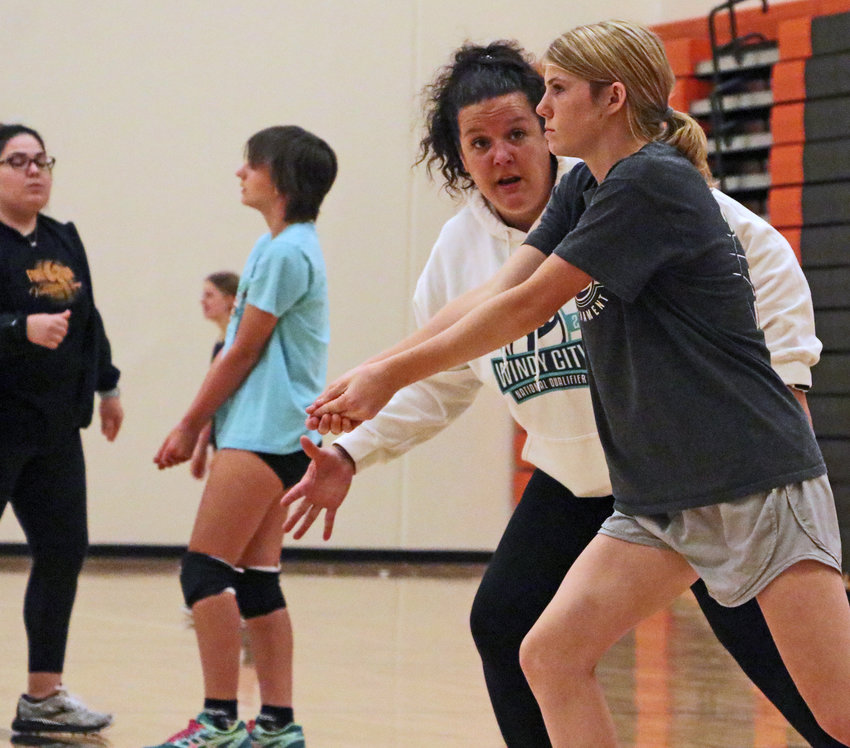 New Pioneers volleyball coach Sarah Rangel instructs seventh-grader Raeann Massey on Wednesday during the Fort Calhoun Volleyball Camp.