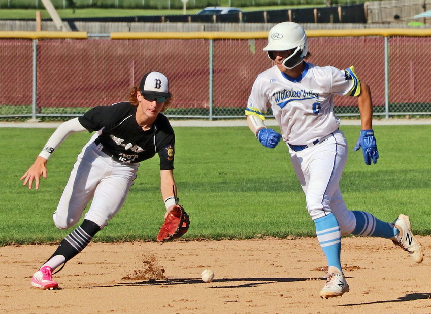 Blair Junior Legion shortstop Nathan Wachter, left, fields a groundball as a Waterloo-Valley races by Sunday at Omaha Roncalli.