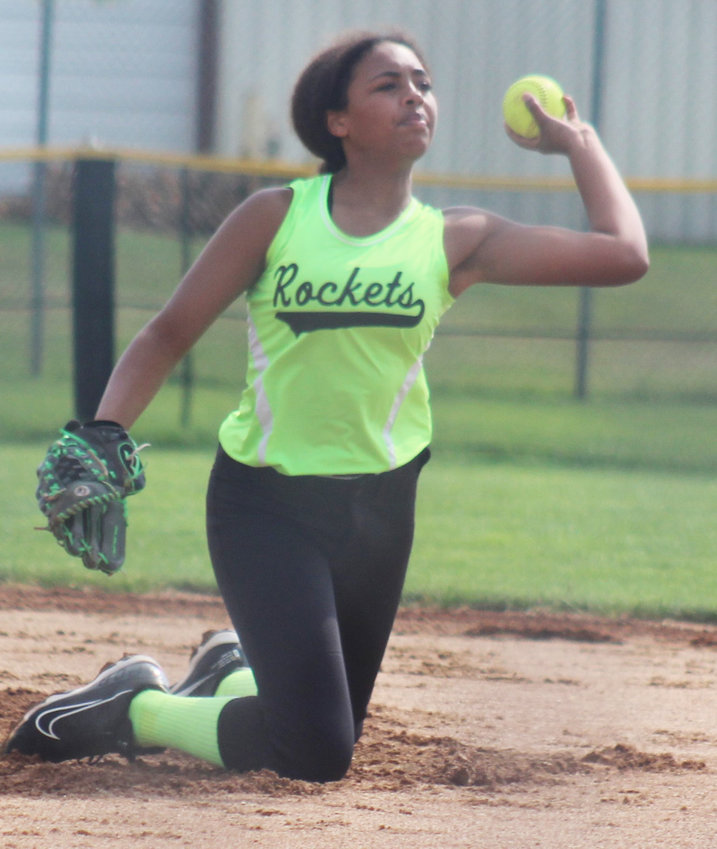 Piper Beltz fields the ball and makes the throw to first base for the out.