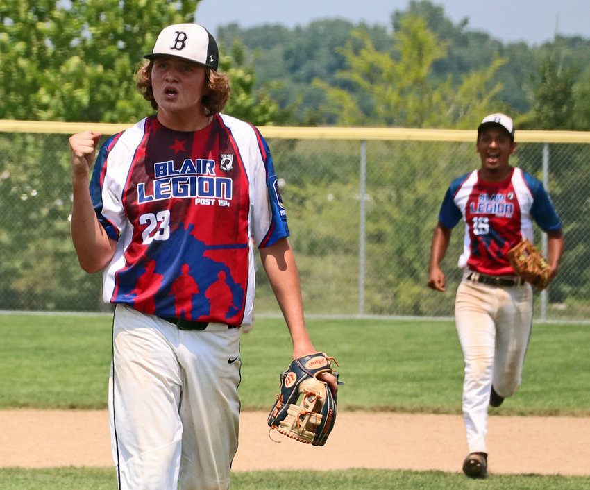 Blair Junior Legion relief pitcher Hunter Travis reacts to the final out of Monday's Class B State Tournament game against Arlington in Waverly.