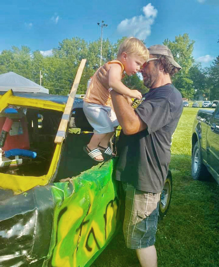 For now little Oliver will just have to watch and check out the derby car, but Jeremy Stammer is more than willing to help introduce his grandson into the world of demolition derbies.