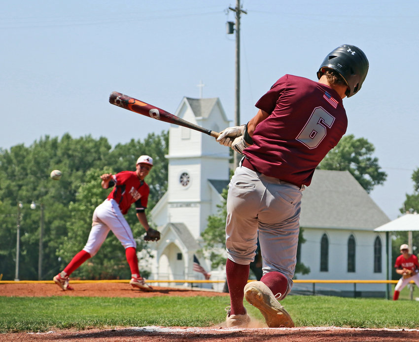 Arlington Senior Legion batter Tanner Pittman puts the ball in play Friday during the Class B Area 3 Tournament in West Point. The Eagles beat Albion in the opener, 8-0.