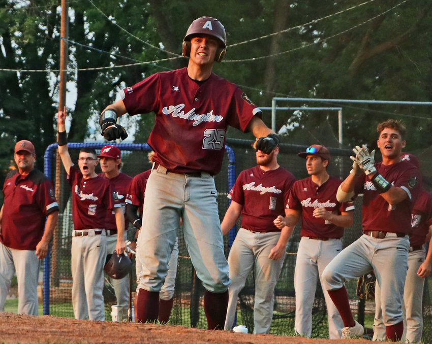 Arlington Senior Legion baseball player Braden Rump and the Eagles dugout welcomes another run home Monday in West Point.
