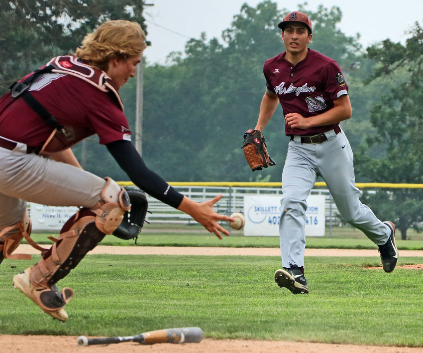 Arlington Senior Legion pitcher Zach Vanek, right, rushes in as catcher Nick Smith grabs an Alliance bunt Saturday during the Class B State Tournament in Crete.