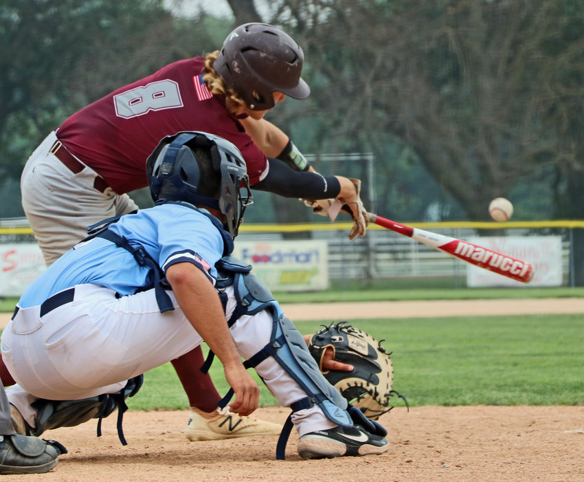 Arlington Senior Legion batter Nick Smith reaches on a single swing Saturday against Alliance during the Class B State Tournament in Crete.