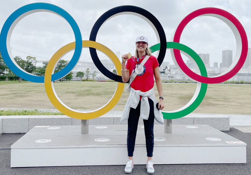 Standing in front of the iconic Olympic rings, Hooper native Jordan Larson shows off her gold medal.