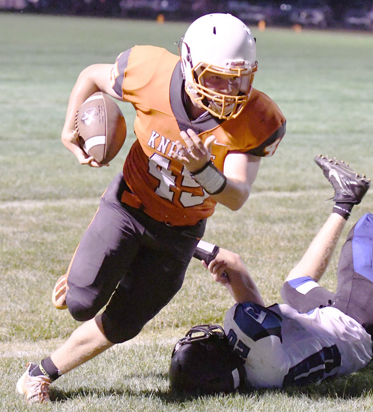Corbin Guill shakes off a Ponca tackler and leaves him laying on the field.