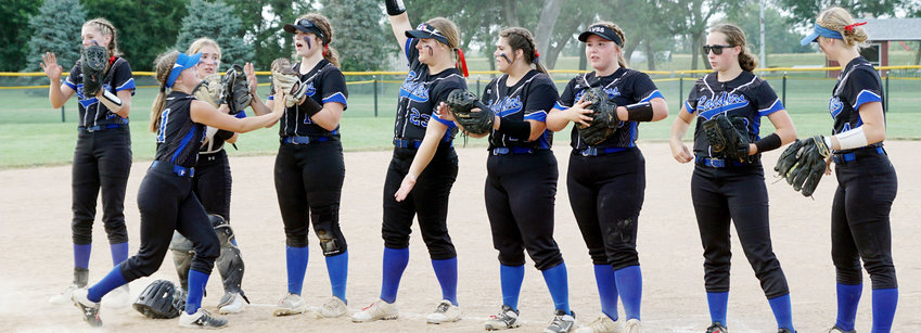 The Lady Raider Softball team gets fired up as the starting lineup is introduced before the first pitch against North Bend Central.  The Lady Raiders defeated NBC in the season opener 21-16.