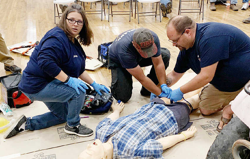 Led by Squad Captain Jamie Johnson (left) Oakland's EMT crew treated the simulation like the real thing. Dominick Seery (middle) Jason Redding-Geu (right).