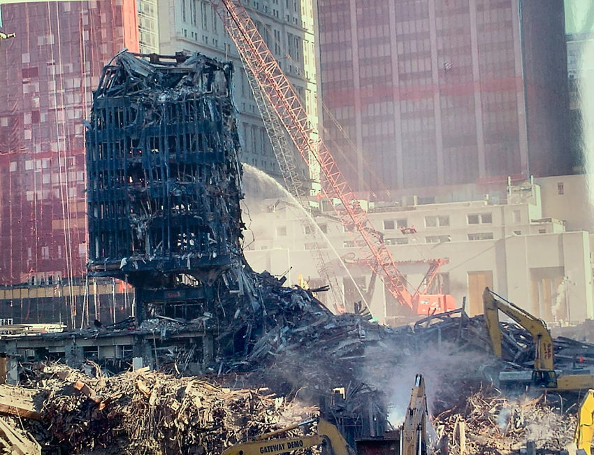 Water is sprayed onto the ruins of the World Trade Center at Ground Zero in November 2001.