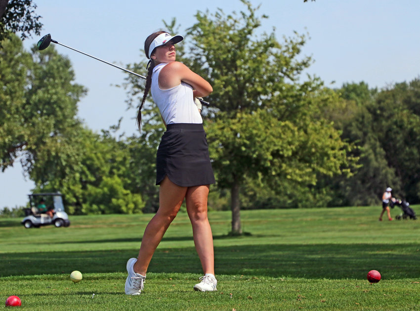Blair senior Anna Moore tees off on No. 6 Monday at River Wilds Golf Club.