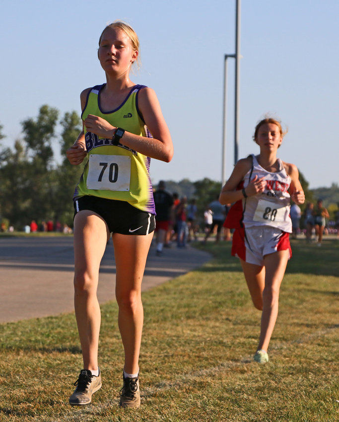 Bears junior Chloe Schrick, left, competes Sept. 16 during the Blair Invite. Last Thursday, the BHS standout led her team to a fourth-place finish in Lincoln.