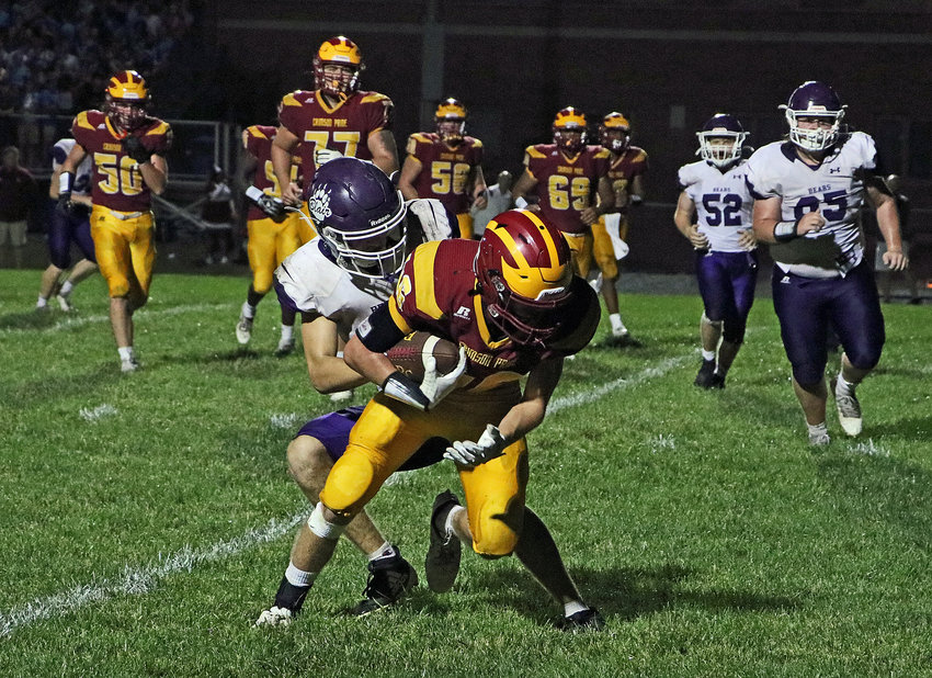 Blair senior Conner O'Neil drags down the Pride's Tanner Post on Friday at Omaha Roncalli. The Bears lost 40-12, falling to 1-5 on the season.