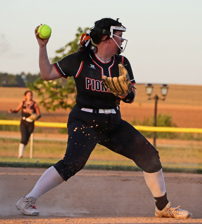Fort Calhoun third baseman Morgan Therkildsen throws to first for an out during a game earlier this season. On Saturday, the Pioneers went 1-1 at a NEN triangular.