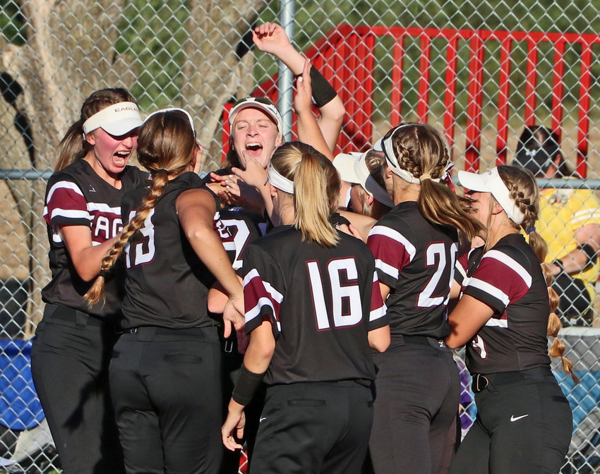 The Arlington Eagles celebrate Gracie Herman's first home run at home plate Monday in Yutan.