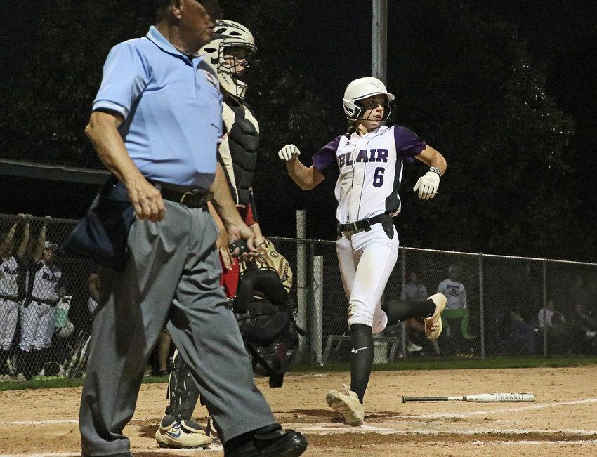 Blair base runner Tessa Villotta scores a run against Ralston on Tuesday during the Class B2 Subdistrict Tournament at Omaha Skutt.