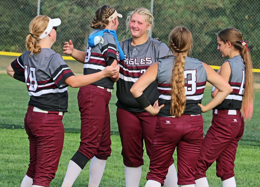 Arlington seniors Julia Landauer, from left, Gracie Herman, Hailey Brenn, Paige Kraemer and Johna Moural share a moment after Friday's Class C5 District Final in Malcolm.