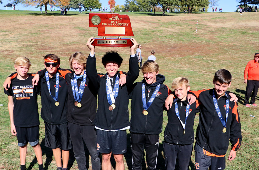 Fort Calhoun's Gage Nixon, from left, Johnathon Schwarte, Lance Olberding, Jacob Rupp, Ely Olberding, Travis Skelton and Lawson Tjardes are 2021 Class B cross-country champions.