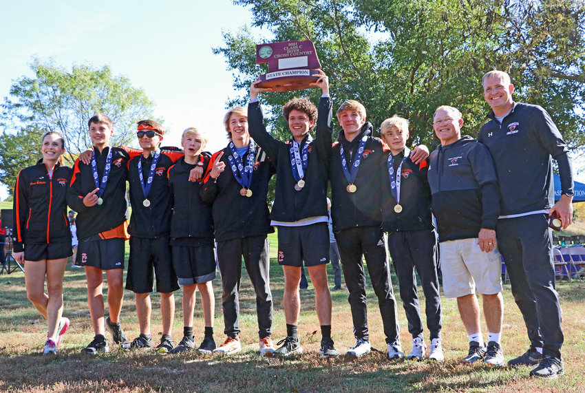 The Fort Calhoun boys cross-country team won a Class C state title Friday during the NSAA State Championships at Kearney Country Club. Pictured are coach Rebecca McMahon, from left, Lawson Tjardes, Johnathon Schwarte, Gage Nixon, Lance Olberding, Jacob Rupp, Ely Olberding, Travis Skelton, coahc Jim Meyer and coach Kyle McMahon.