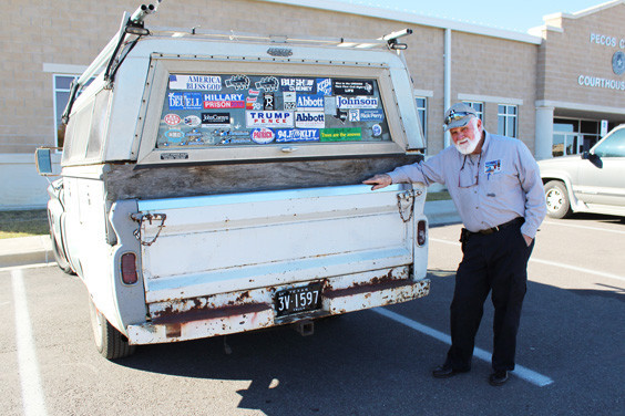 John Ball of Garland leans on his vintage truck, which showcases a large collection of bumper stickers.