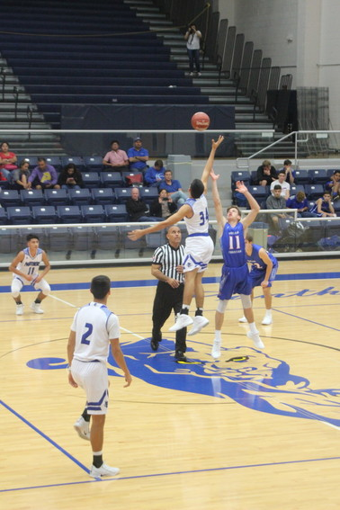 Panther Basketball tipped off  Tuesday night with Luis Guerra making the leap for the Panthers.
