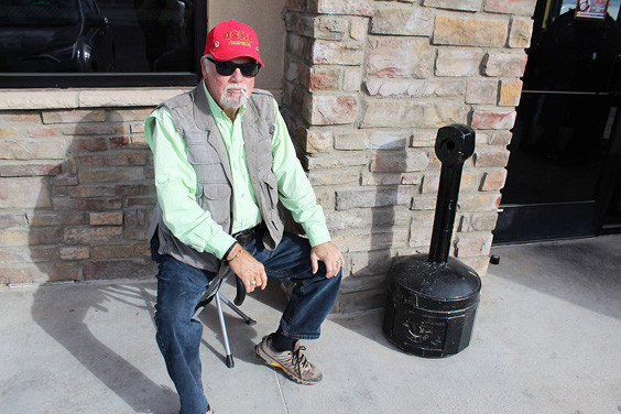 Before traveling to New Braunfels, Tom Wilson took a seat on his portable stool for a quick smoke break in front of the Carl's Jr. here in town.