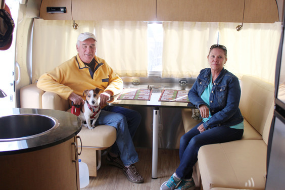 Cutline: Ted and Susan Hannon relax inside their Airstream with their dog Mac as they set off for a Lajitas adventure.