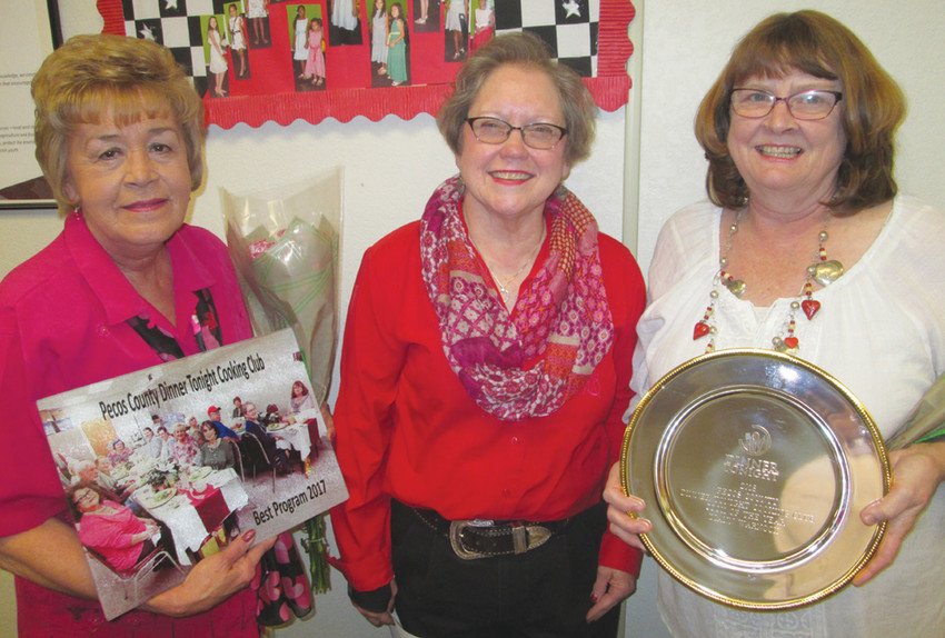 Karan Heffelfinger (center) stands with Glenda Bonham (left) and Diann Warnock (right) after they have both been awarded for their achievements.
