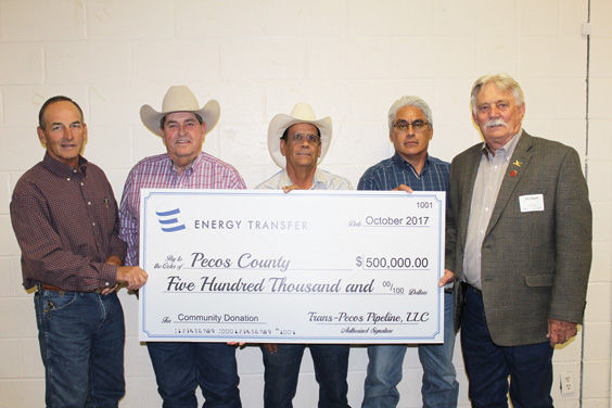 Commissioners Mickey Perry, Tom Chapman, Lupe Dominguez, Santiago Cantu and Judge Joe Shuster accepted a $500,000 community donation from Trans-Pecos Pipline L.L.C.