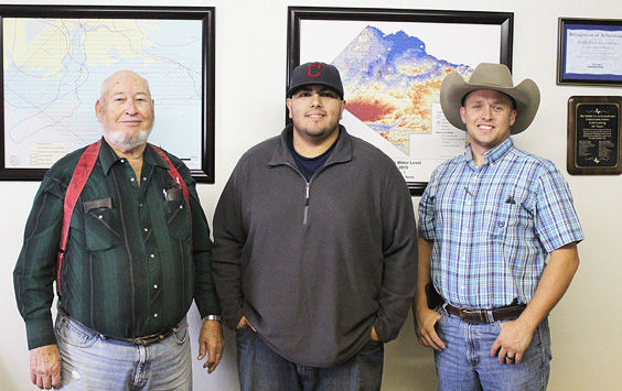 Departing Field Technician of six years Harvey Gray, new Field Technician Morgan Williams, and MPGCD General Manager Ty Edwards