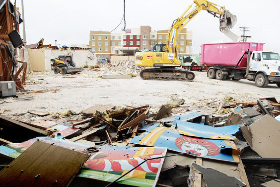 The longstanding McDonald's and its PlayPlace went down in grand fashion with remnants of Ronald McDonald's smiling face anticipating the new building.