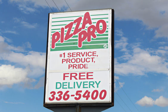 A dreary sky hovers above the Pizza Pro sign after restaurant owner Gerardo Pules shut down the business for good. Even with the dark skies, Pules looks forward to a bright future following his run with Pizza Pro.