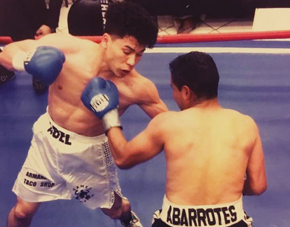 Abel Mendoza (left) in action, takes a swing at his opponent.