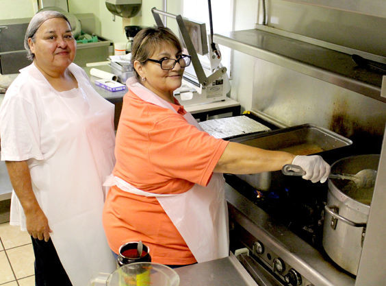 Margie Pacheco and Laura Lujan are up bright and early preparing food for senior citizens who need meals here in Fort Stockton.
