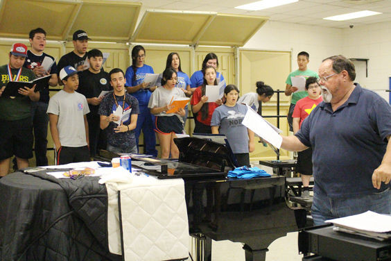 Mr. Gennette conducts the choir as they practice all the pieces one last time before departing for New York City and Carnegie Hall.